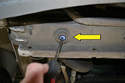 Locate the plastic drain plug on the bottom of the lower front passenger side of the radiator (yellow arrow).