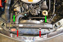 Undo the clips holding the shroud to the radiator (green arrows) and radiator to the frame (red arrows).