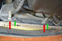 Disconnect the transmission oil coolant lines (red arrows) from the lower part of the radiator.