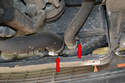 Undo and remove the two lower hoses from the radiator (red arrows).