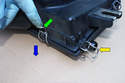 To unclip the spring clips position you finger on the tang (green arrow) and move it in the direction of the blue arrow until it unclips and is in its unlocked position (yellow arrow).