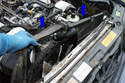 Slide the shroud upwards in the direction of the blue arrows and remove it from the engine compartment.