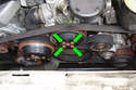 Working at the front of the engine loosen the four 10mm fasteners (green arrows) that hold on the coolant pump pulley (green arrow) while the belt is still on the pulley.