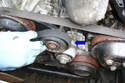 Remove the accessory drive belt from the front of the engine.
