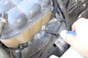 Remove the lower hose clamp on the bottom of the expansion tank and pull the hose off.