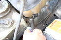 Remove the larger hose clamp on the bottom of the expansion tank and pull off the hose.