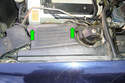On the driver side remove the two Phillips head screws (green arrows) and lift up on the inner fender cover.