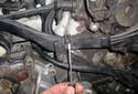 The spark plug wires are routed in plastic sheathing.