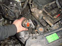 Remove the first ignition coil from the engine compartment.