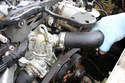 Loosen the clamp on the upper radiator hose and remove the hose from the neck.