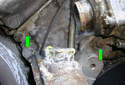Once the hose is removed, remove the two 13 mm fasteners (green arrows) that hold on the top of the coolant pipe.