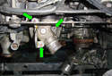 Remove the three 5 mm Allen head fasteners (green arrows) that mount the bleeder screw housing.