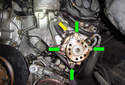 This photo illustrates the front of the power steering pump and reservoir housing.