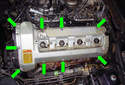 Remove the nine 4 mm fasteners (green arrows) that hold down the valve cover.