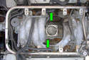 Remove the two crankcase breather hoses (green arrows).