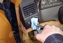 Use a rag to cover the headlight switch knob and grab it with a pair of pliers.