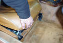 Lift up the front of the lower seat cushion and remove the seat cushion from the car.