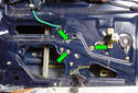 To remove the power window motor remove the three 10mm fasteners (green arrows).