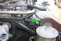 Here we are at the front left cylinder head of the engine on the intake manifold side we see the camshaft position sensor (green arrow)
