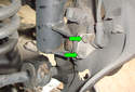 Remove the two 6 mm Allen head fasteners (green arrows).