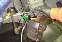 First install a 9mm line wrench (yellow arrow) on the caliper bleeder screw then put the drain hose on the bleeder screw nipple (green arrow).