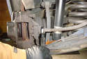 Rear Brake Caliper Using a 14 mm line wrench, loosen the brake hose, you will remove it later.