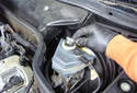 With the brake fluid reservoir cap already removed, remove the strainer.