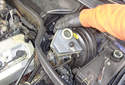 Remove the brake fluid reservoir by pulling straight up on it until it detaches from the grommets.