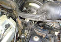 Lift the engine compartment seal out of the way of the vacuum supply line for the brake booster.
