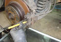 Rear Brake Pads Use a roll pin punch and hammer to tap out the upper brake pad retaining pin.