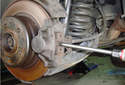 Rear Brake Pads Use a flat head screwdriver or pry bar to push the inner brake pad away from the rotor.