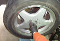 Certain Mercedes Benz rims do not lend themselves to adjusting the parking brake with the wheel on.