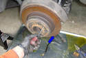With the wheel removed adjust the parking brakes to tighten until you can no longer turn the brake rotor.