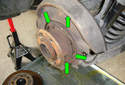 Clean the backing plate with brake clean and apply a small amount of lubricant to where you see the parking brake shoe come in contact with the backing plate (green arrows).