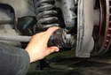 Remove the outside sway bar bushing bracket from the lower control arm.