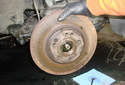 Remove the brake rotor and hub from the spindle.