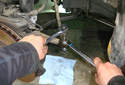 Using a 19mm wrench, remove the tie rod end fastener.