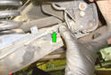 This Picture illustrates under the rear of the car on the left side looking at the inner part of the lower control arm.
