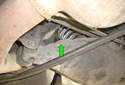 On the front side of the control arm remove the 10mm fastener (green arrow).