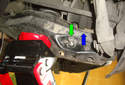 Use a jack to support the lower control arm.