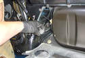 Remove the rear shock absorber upper bushing from the top of the rear shock absorber.
