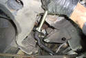 Working back at the right side of the center link, use a splitting fork to separate the center link from the idler arm.