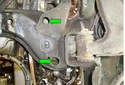 If you do not want to use this method you can remove the two bolts recessed in the sub-frame (green arrows) to loosen the motor mount.
