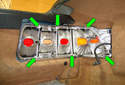 Remove the six 8mm fasteners from the tail light mounting frame.