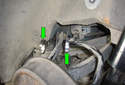 Using two 9mm wrenches (green arrows) remove the fasteners that hold the link to the sub-frame.