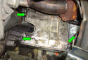 This Picture illustrates underneath the car on the right side of the engine, looking up at the starter motor heat shield.