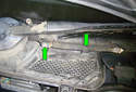 Remove the two Phillips head fasteners (green arrows) for the windshield wiper motor cover.