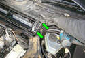 Lift the wiring harness for the ambient air temperature sensor from its groove in the cabin air filter housing (arrows).