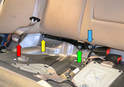 Next remove the T45 Torx (yellow arrow) and 13mm nuts (green arrow) holding the child safety seat anchor bar.