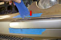 Perform the same work on the upper part of the trim down and away from the bumper (red arrow).